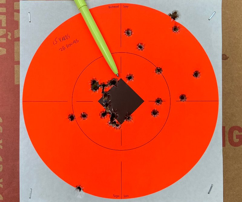 15-yard 28-round group fired with the Hellcat. Fisher Space Pen indicates point of aim. (Photo © Russ Chastain)