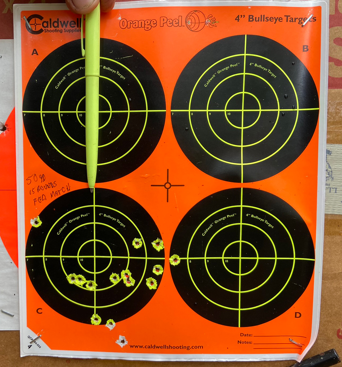 15 rounds at 50 yards with a peep sight in direct sunlight... this is not bad at all. Pen point indicates point of aim. (Photo © Russ Chastain)