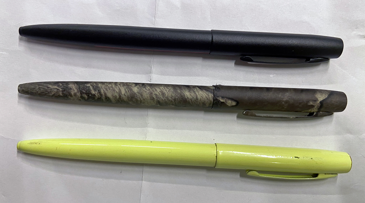 Cap-O-Matic Space Pens in Firefighter (top), TrueTimber, and Tradesman Yellow (bottom). (Photo © Russ Chastain)