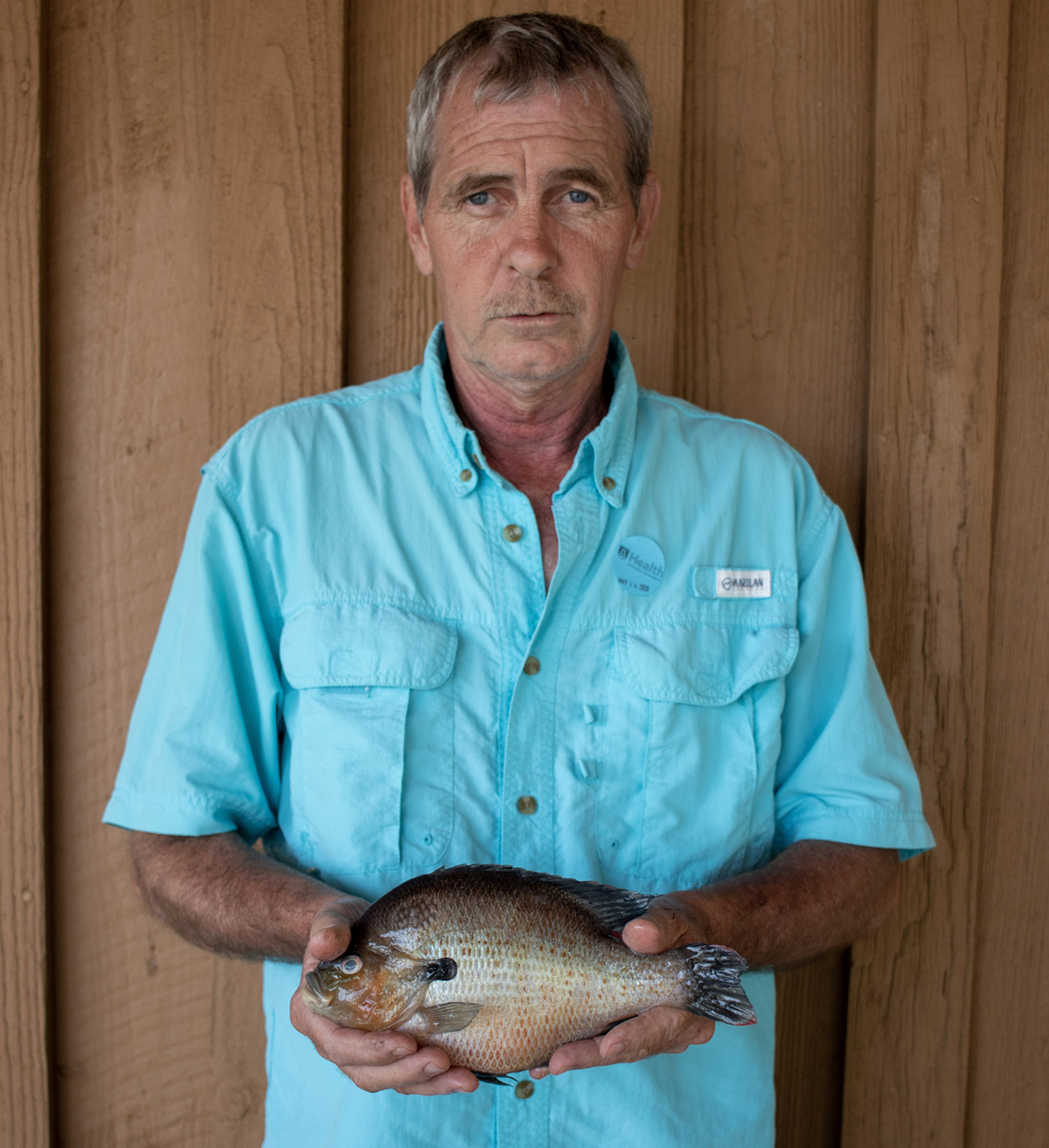 Danny Vann with his record-setting redbreast. Doesn't look very happy, does he?