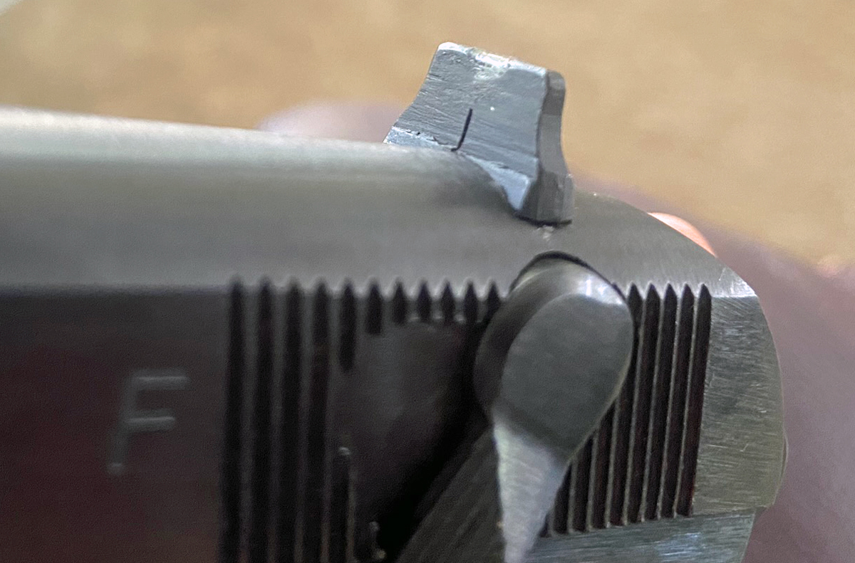 Front of rear sight shows an odd mark or deformation. (Photo © Russ Chastain)