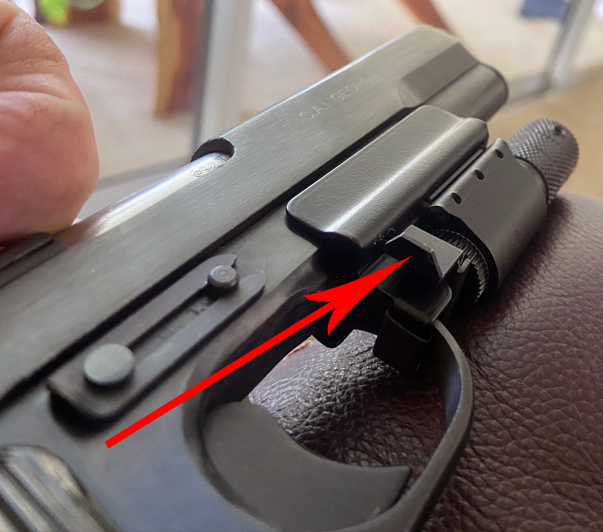 No notch in the rear sight? Add a laser! This magnetic-mount Ramlite laser is interesting. Arrow points to the paddle; press it forward to switch on the red laser. (Photo © Russ Chastain)