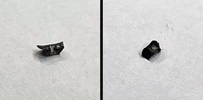 """A test scrape exposed something whitish and softer than steel (left). A little more force popped this hunk of """"stuff"""" off of the sight! (Photo © Russ Chastain)"""
