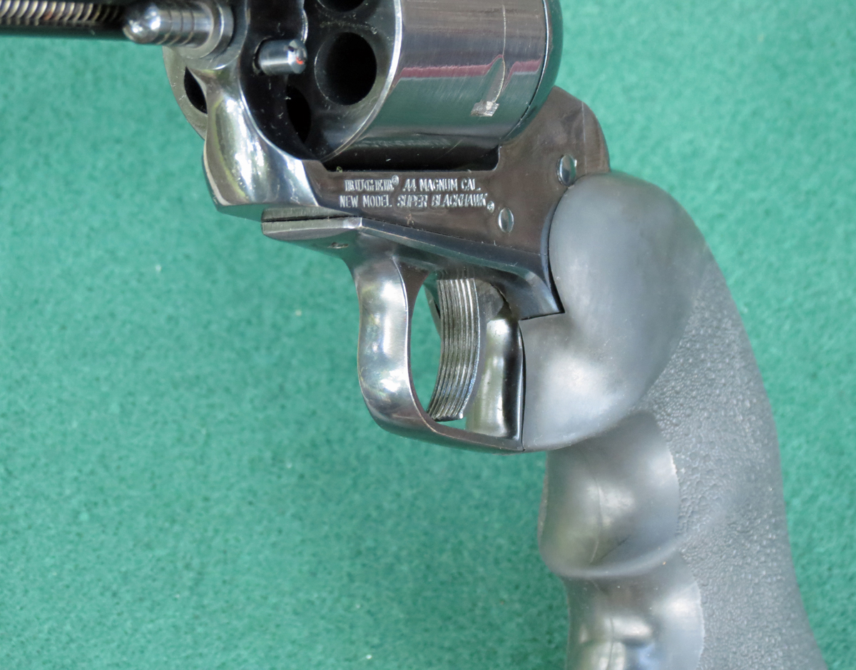 Wide, grooved trigger on a Suger New Model Super Blackhawk 44 magnum revolver. (Photo © Russ Chastain)