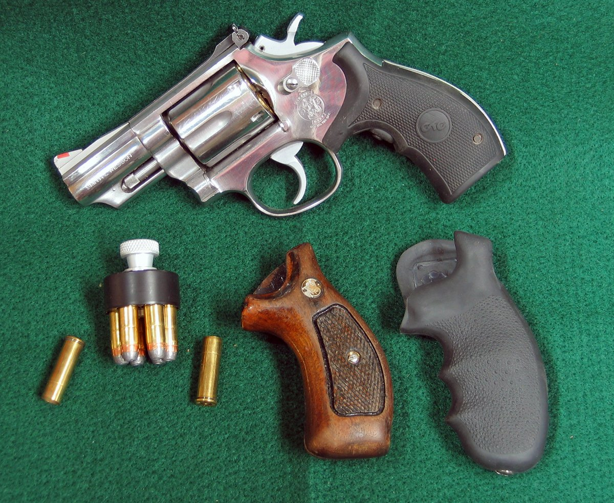 S&W Model 66-2 revolver with speed loader, extra grips, and a couple empty shells. (Photo © Russ Chastain)