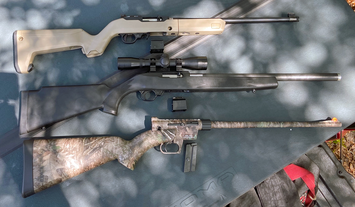 A trio of 22s. Top to Bottom: Ruger 10/22 Backpacker Takedown, Ruger 10/22 with Butler Creek stock & barrel, Henry US Survival AR-7. (Photo © Russ Chastain)