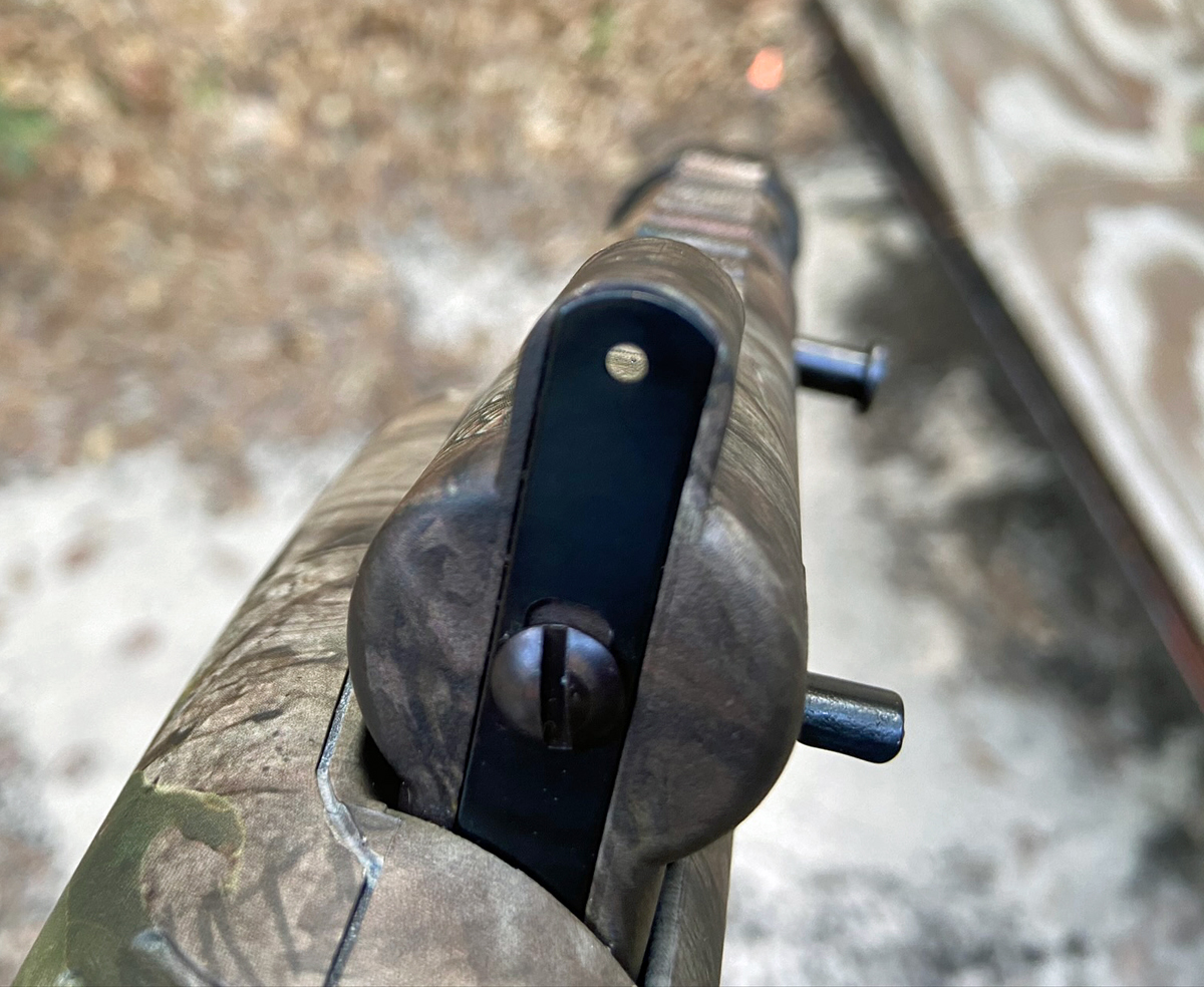 The rear sight is a simple steel strip with a hole at either end. (Photo © Russ Chastain)