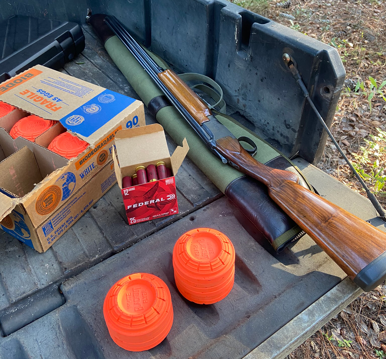 Some clays, some shells, and my favorite old shotgun. (Photo © Russ Chastain)