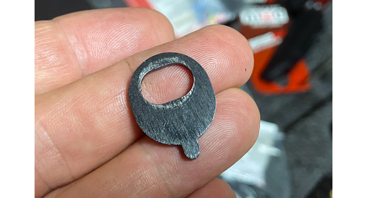This unmarked washer/key was used on the unshimmed butt stock. (Photo © Russ Chastain)