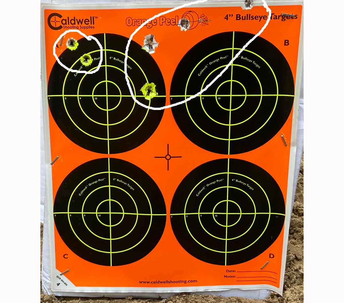 Two groups at 150 yards. The barrel had gotten hot, so it was time to quit. (Photo © Russ Chastain)