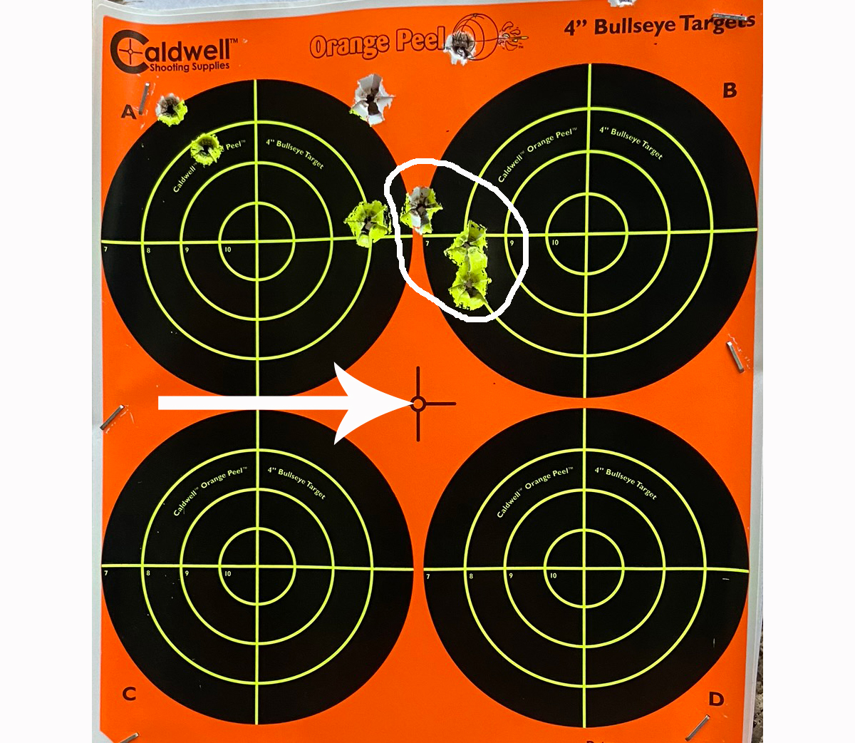 "A 1-1/8"" 3-shot group at 150 yards? Yes, thanks. Arrow indicates point of aim. (Photo © Russ Chastain)"