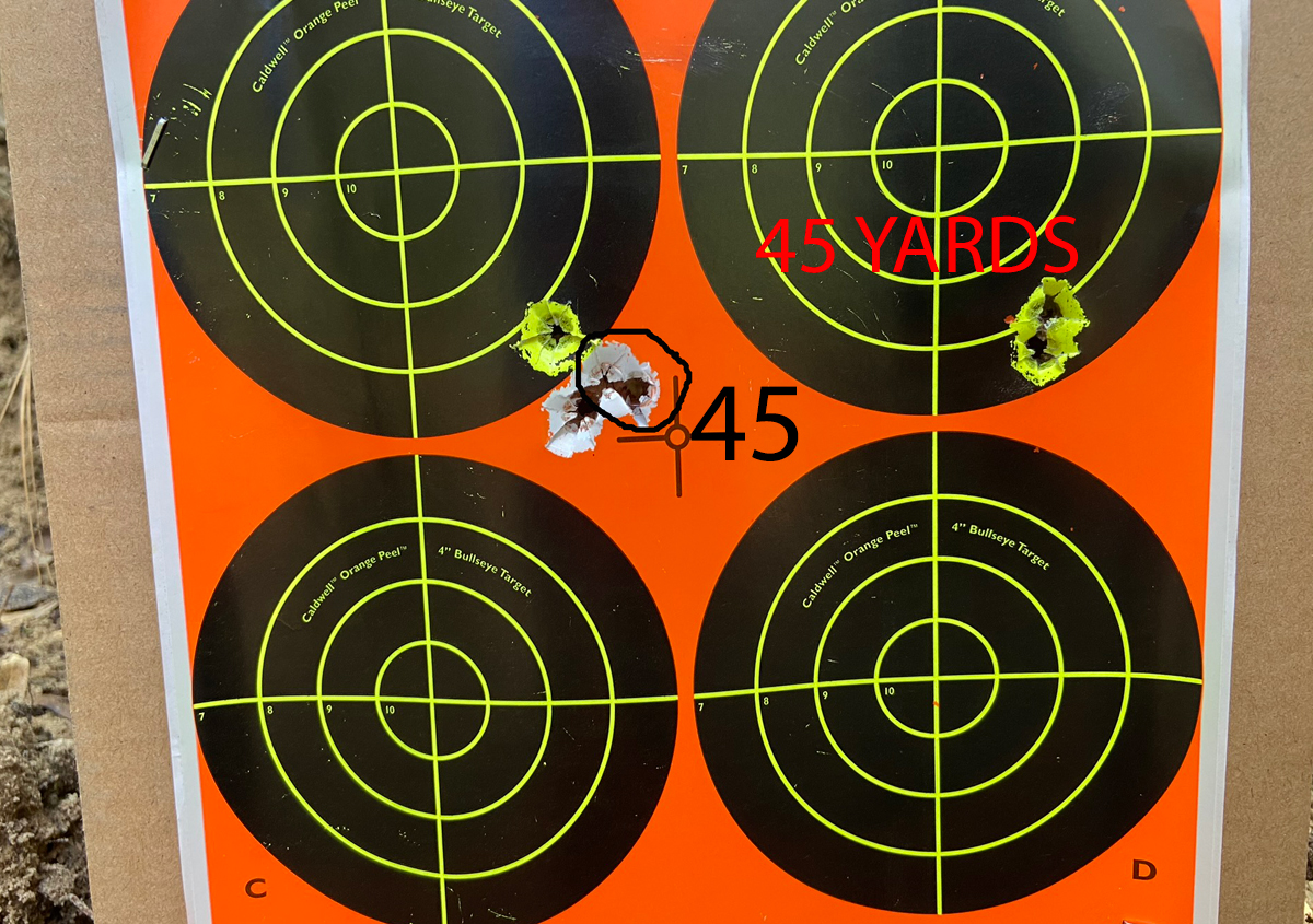 I aimed at the center of the target; fired the right group & adjusted, then fired the circled 45-yard group. Moved to 100 yards to fire the other two shots. (Photo © Russ Chastain)