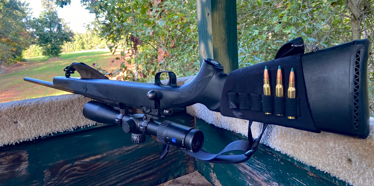 A favorite rifle in a dependable doe-hunting stand. (Photo © Russ Chastain)