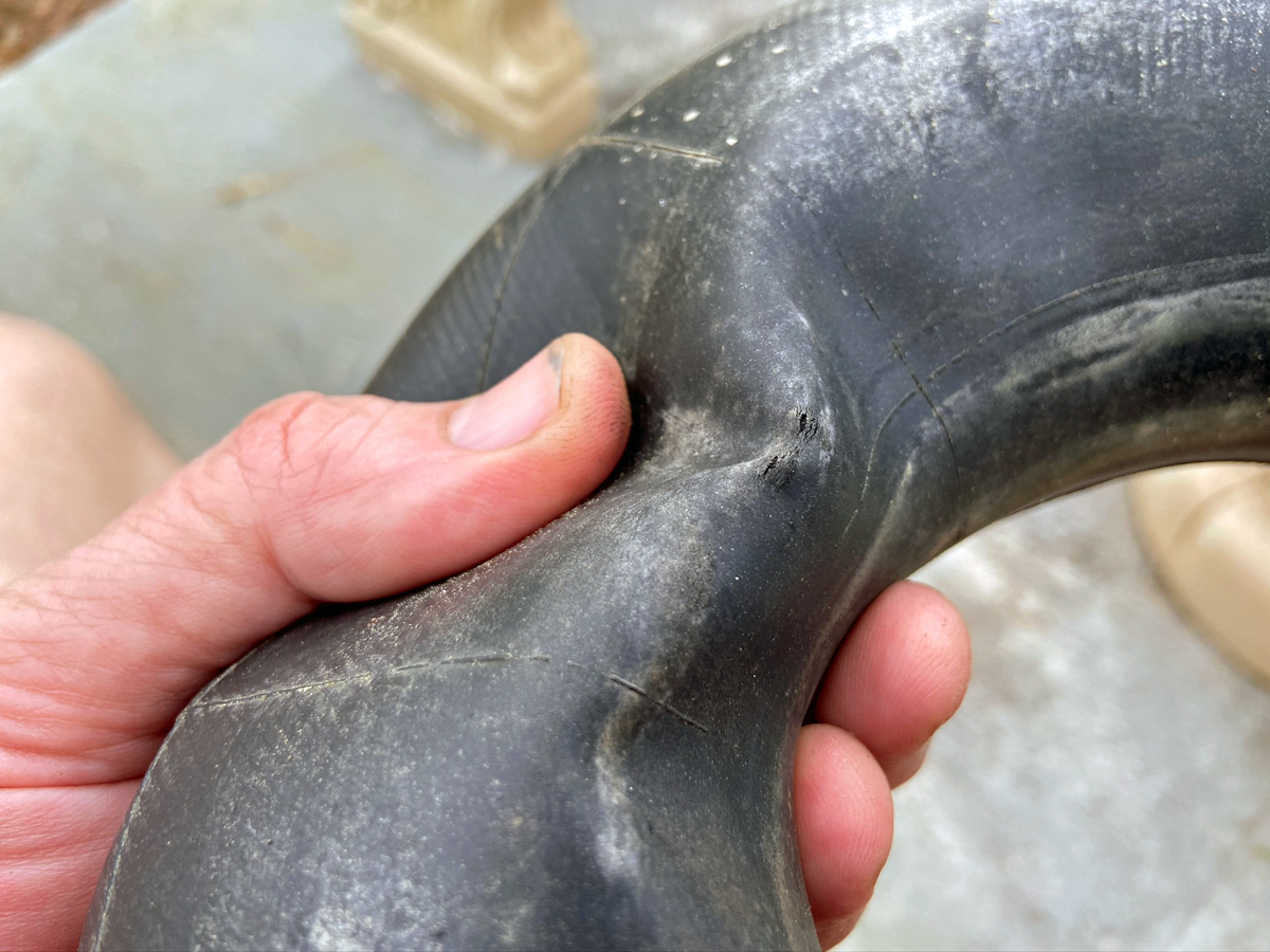 Pinched innertube was leaking badly (Photo © Russ Chastain)